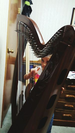 Harp Precious Little Moments Capture The Moment Popular Eyem And Getty Collection This Week On Eyeem USA Photos EyeEm Gallery Musical Instrument Childhood Children Photography Children Of The World Lifestyles Check This Out! Child Eyes Innocence Playing Music Captured Moment