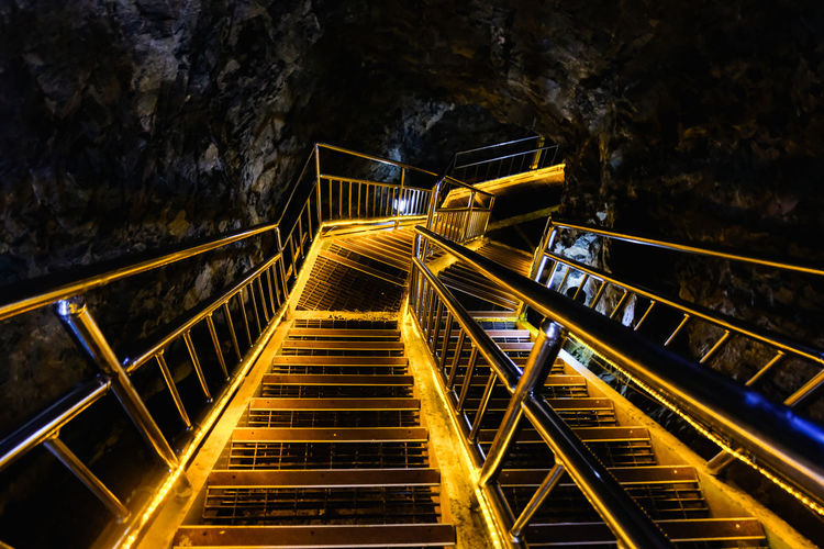 Bridge illuminated by lights in a cave