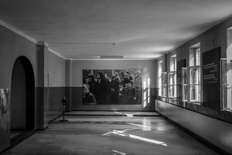 Auschwitz Auschwitz Birkenau Auschwitz  Architecture Indoors  Built Structure Building No People Flooring Wall - Building Feature Empty Day Corridor Ceiling Entrance Arcade The Way Forward Direction Absence Lighting Equipment Door Sunlight Architectural Column