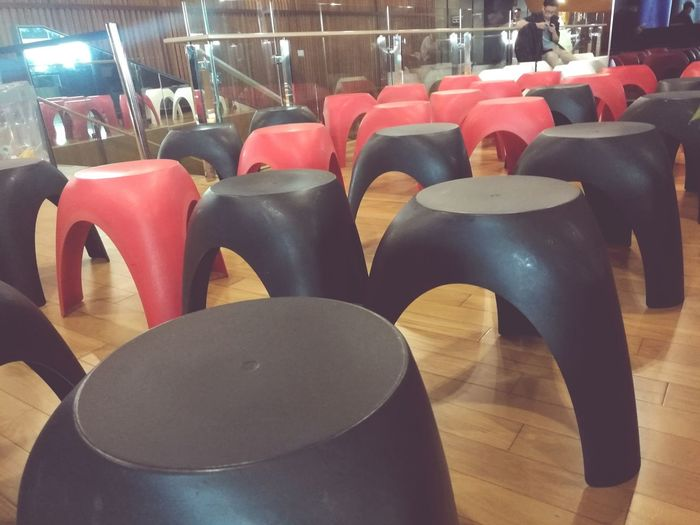 Indoors  Business Finance And Industry No People Store Factory Day Close-up Chairs Chairs Seats Chairs In Rows Black And Red