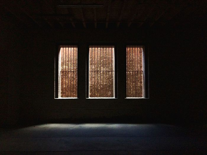 Brick Wall Seen Through Windows
