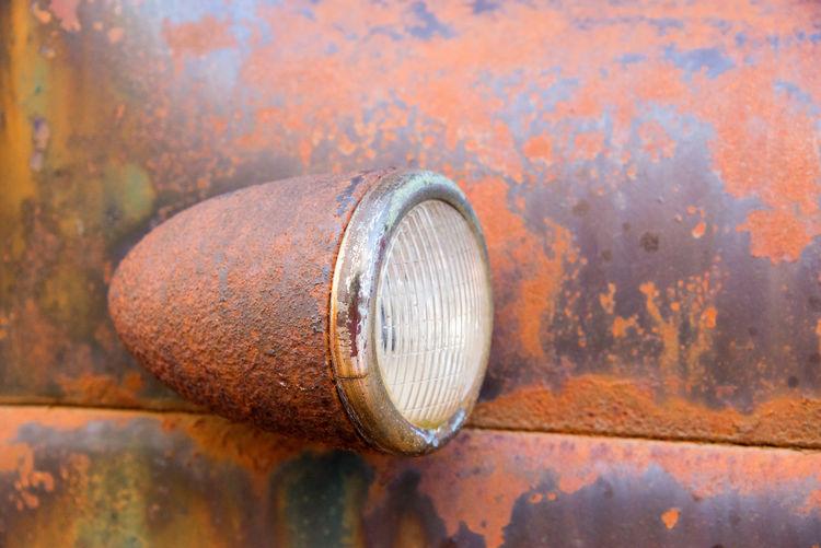 Headlight of rusty dodge truck