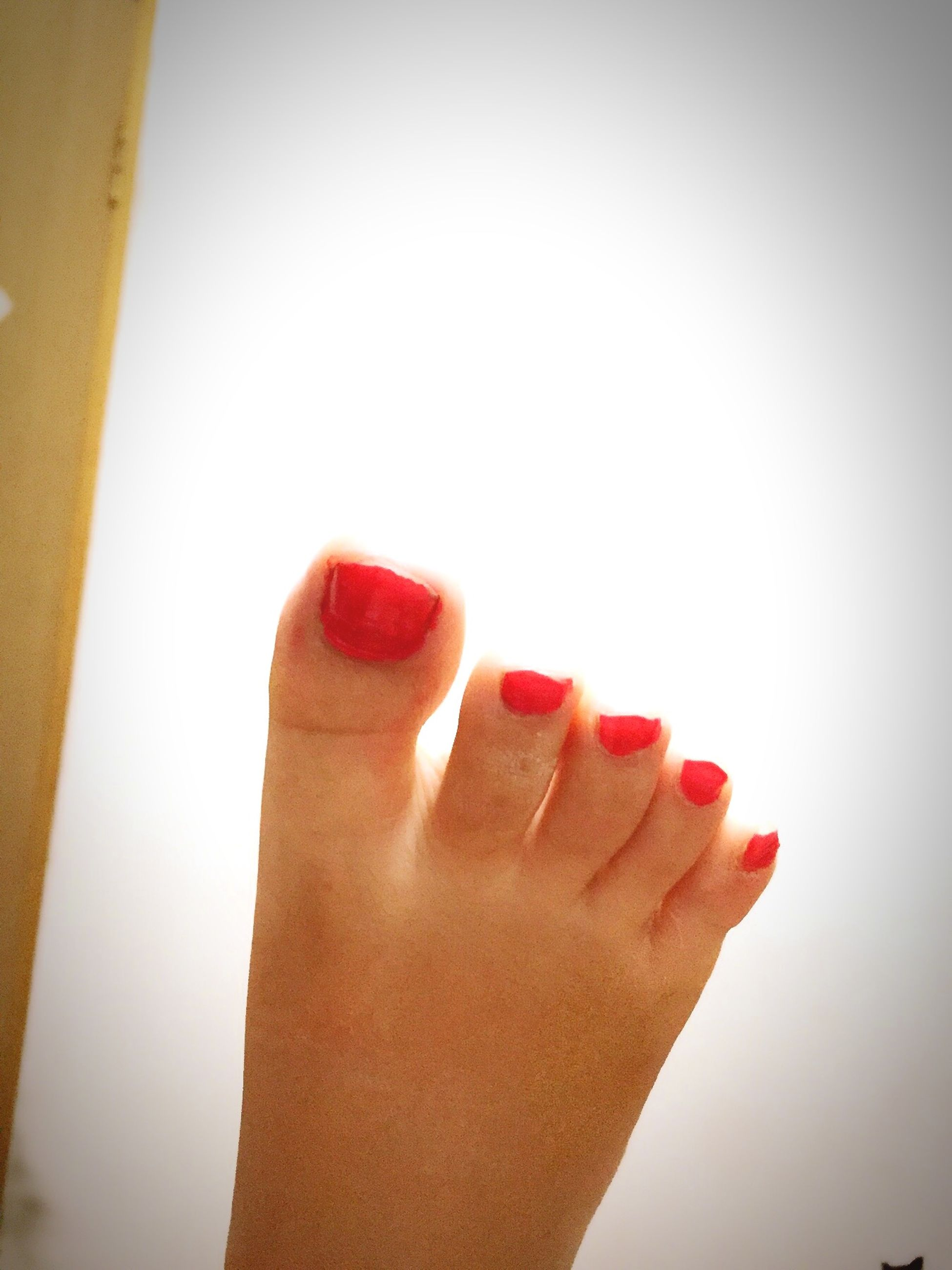 person, part of, cropped, holding, human finger, copy space, personal perspective, close-up, unrecognizable person, red, studio shot, white background, freshness, nail polish, food and drink, focus on foreground, showing
