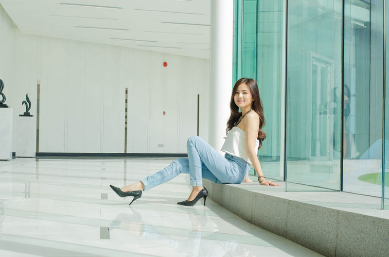 Beautiful Asian woman sit comfortably. cute girl Beautiful Beautiful Girl Relaxing Adult Architecture Asaingirls Beautiful Woman Building Exterior Built Structure Casual Clothing Day Full Length Happiness Leisure Activity Lifestyles Looking At Camera One Person One Young Woman Only Outdoors People Real People Relaxing Time Smiling Young Adult Young Women