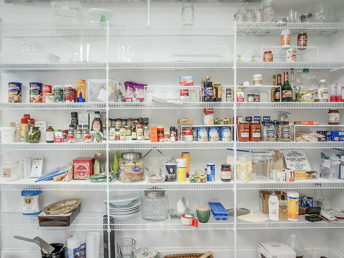 Various Products On Shelf In Pantry