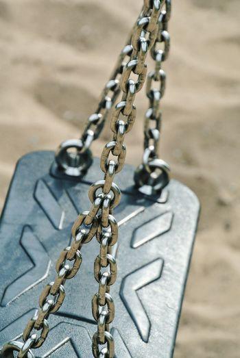 Detail Shot Of Empty Swing