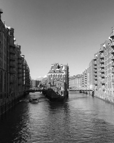 Architecture Building Exterior Built Structure Waterfront Clear Sky Water Travel Destinations Outdoors City Sky No People Day Public Transportation Black And White Blackandwhite Photography Black & White Bnw Tourism Travel Streetphotography Light And Shadow Historical Building Speicherstadt Hamburg Monochrome Nautical Vessel