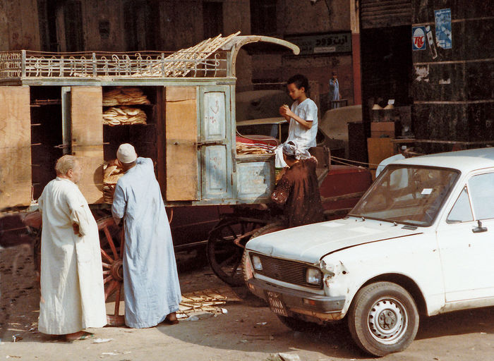 A baker delivering his bread on the streets of Cairo - Egypt A Taste Of Cairo Bakers Van Egypt Life In Cairo Adult Adults Only Architecture Baker Day Delivery Vehicle Egyptian Bread Full Length Men Old-fashioned Outdoors People Young Adult Business Stories Stories From The City