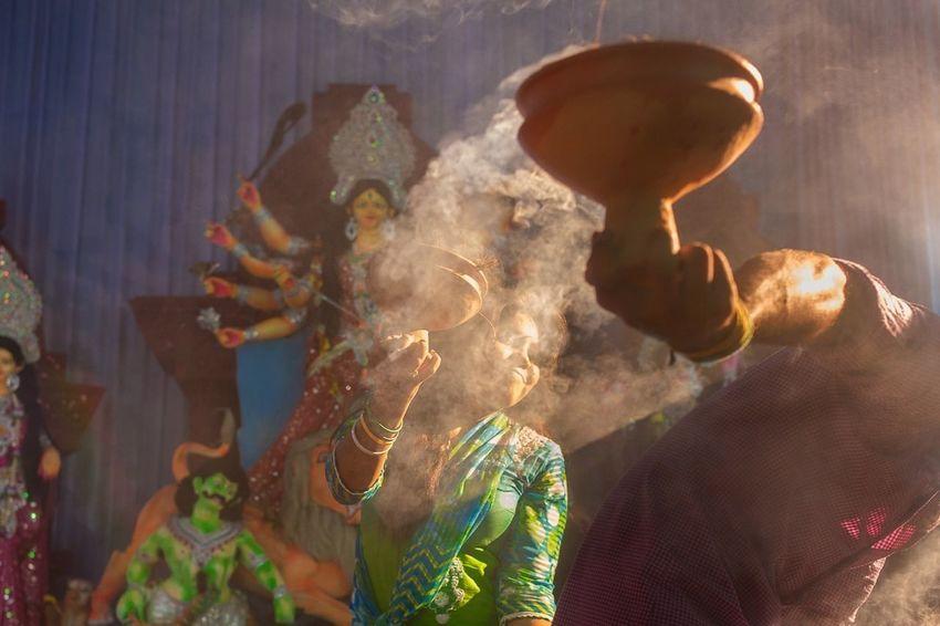 A devotee worships Hindu goddess durga's idol with traditional ritualistic dance at narayangonj, Bangladesh | 2013 The Illuminator - 2014 EyeEm Awards Hindu Dance