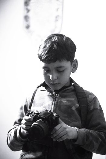 Man photographing with camera