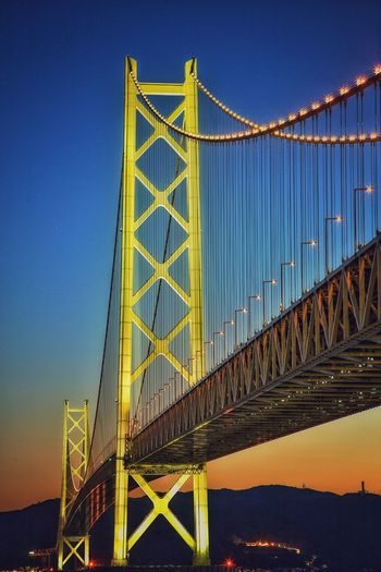 beautiful bright and sunset City Suspension Bridge Bridge - Man Made Structure Metal Sky Architecture Built Structure Travel Engineering Chain Bridge Girder Bridge Skyline Footbridge Railway Bridge High Voltage Sign Covered Bridge