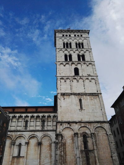 History Travel Destinations Religion Clock Tower Cloud - Sky Architecture City Sky Clock Building Exterior Built Structure Low Angle View Outdoors Cityscape Day No People Clock Face Politics And Government Lucca Lucca Italy Lucca Centro Duomo Torre Architecture Architettura