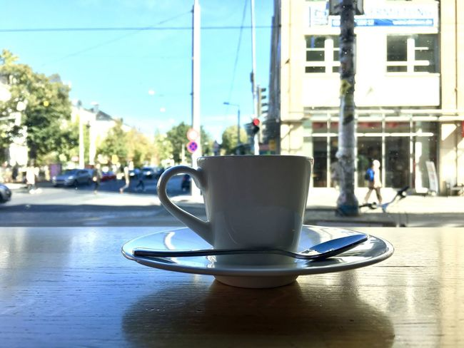 Espresso Architecture Building Exterior Cafe City Coffee Coffee - Drink Coffee Cup Coffee Shop Crockery Cup Day Drink Focus On Foreground Food And Drink Incidental People Mug Refreshment Saucer Sunlight Table