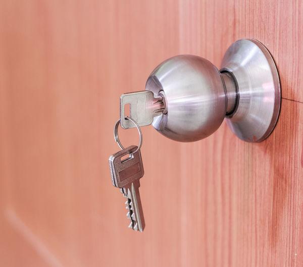 Close-up of key in doorknob