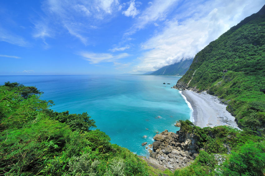 Hualien Taroko National Park, a mysterious trip Taroko National Park Clear Water Cliffs Suhua Highway Taiwan Beauty In Nature Blue Cloud - Sky Cool Feeling Day Horizon Over Water Idyllic Landscape Mountain Nature No People Outdoors Rock - Object Scenics Sea Sky Tranquil Scene Tranquility Travel Destinations Tree Water