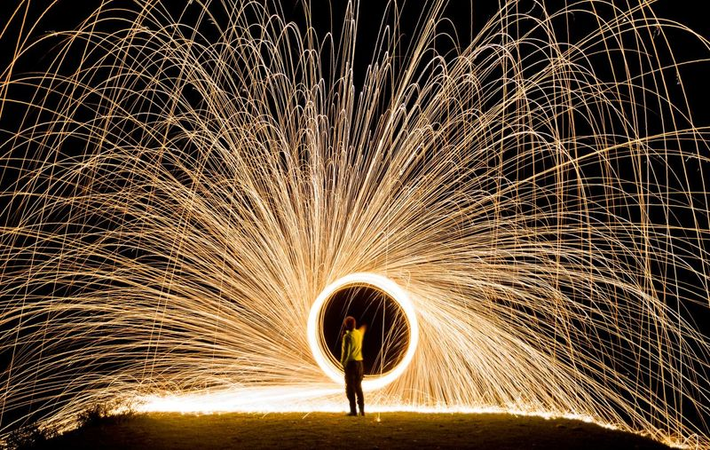 Woman With Wire Wool At Night