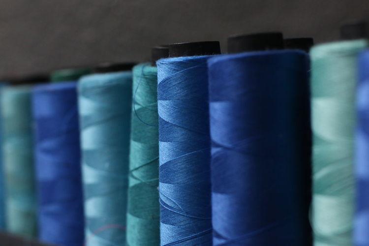 Blue thread. sewing thread.