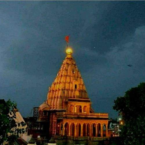 A beautifull view of Sun's rays on the top of Temple. Temple Mahankaltemple Place Of Worship Shiny Things Sun Reflection Sun Reflection On Building