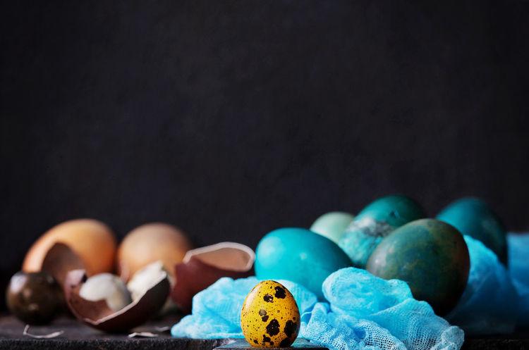 Traditional colored Easter eggs with napkin over dark background Background Blue Celebration Day Easter Easter Eggs Egg Eggs Holiday Napkin Quail Quail Eggs Shell Spring Yellow