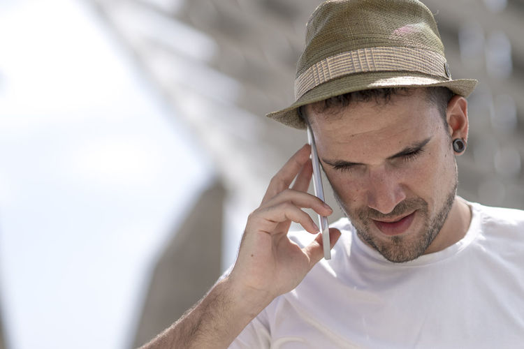 Close-Up Of Man Talking On Smart Phone