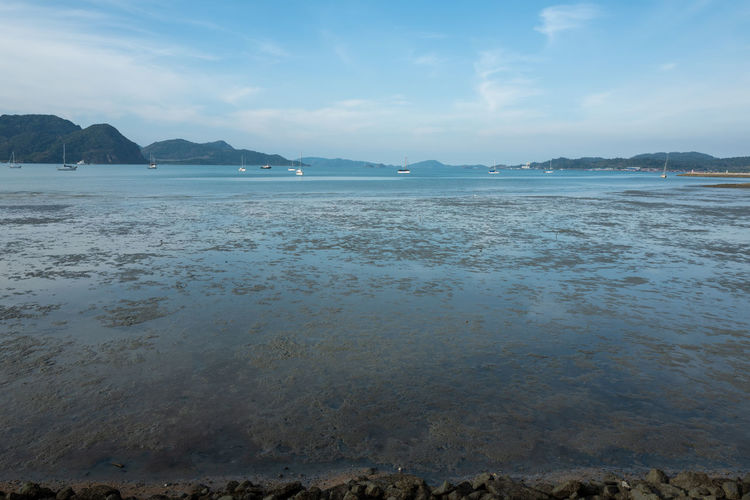 Langkawi Water Sky Scenics - Nature Sea Tranquil Scene Beauty In Nature Land Tranquility Beach Cloud - Sky Nature No People Day Non-urban Scene Idyllic Mountain Outdoors Rock Reflection