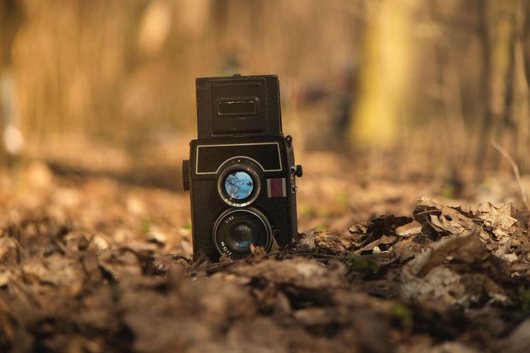 Close-up of camera on field