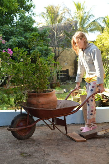 To move the pots Working Girl Girl Power Pot Plant Wheelbarrow