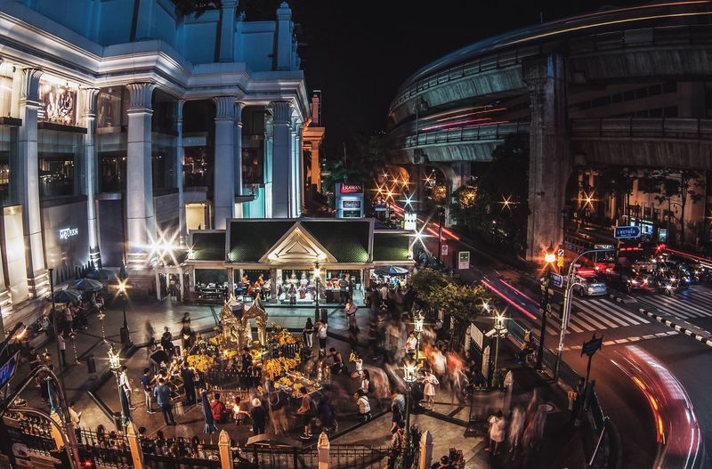 High Angle View Of People At Erawan Shrine In Illuminated City
