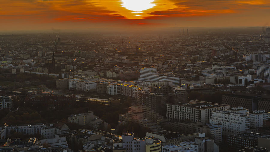 Aerial view of city at sunset