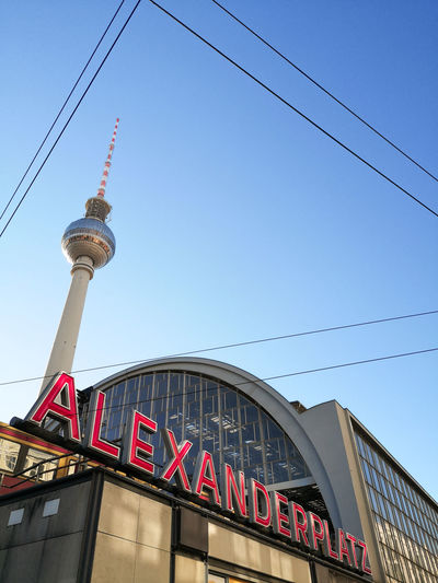 Huaweiphotography Alexanderplatz Berlin Architecture Building Building Exterior Built Structure Cable Capital Cities  City Communication Connection Electricity  Low Angle View No People Outdoors Sky Skyscraper Tall - High Technology Text Tourism Tower Travel Travel Destinations