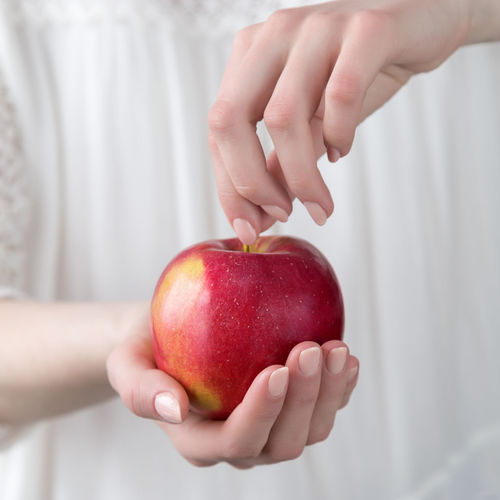 girl holding a red apple in her hand Square Shot Red Apple Give Stretch Out A Hand Shop Vitamin Ripe Juicy Fresh Unrecognizable Person Girl Healthcare Calories Calorie Lose Care Nutrition Health Slimming Slimness Fall Autumn Vegetarian Vegan Clean Eating Healthy Weight Female Hold Hands Choice Weight Loss Losing Weight Overweight Dieting Diet Slim Crop  Harvest Closeup Holding Freshness Fruit Wellbeing Food And Drink Healthy Eating Food Hand Apple