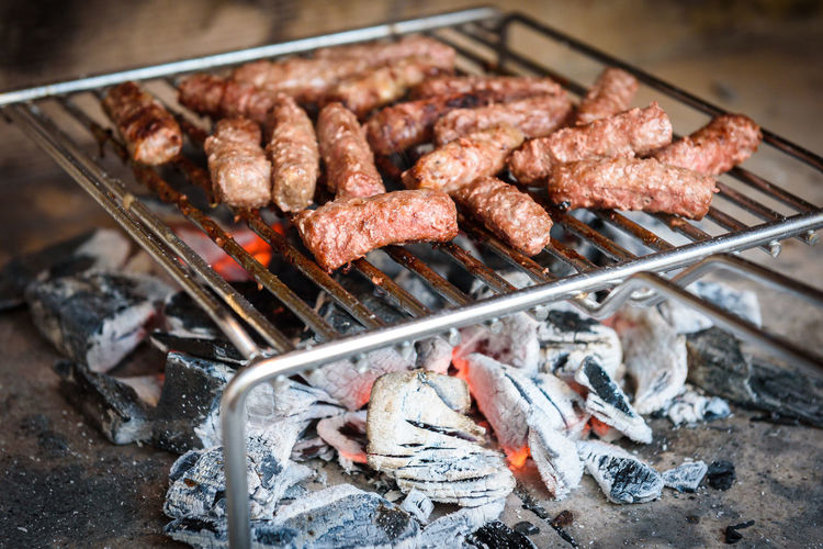 Grilling Meat on barbecue grill with coal. Cevapcici, kebabs, country sausage on charcoal barbecue BBQ in the outside fireplace. Balkan Barbecue Barbecue Grill BBQ Cevapcici Cevaps Fireplace First Eyeem Photo Food Food And Drink Grid Grill Grilled Grilling Kebabs Meal Meat No People Outdoors