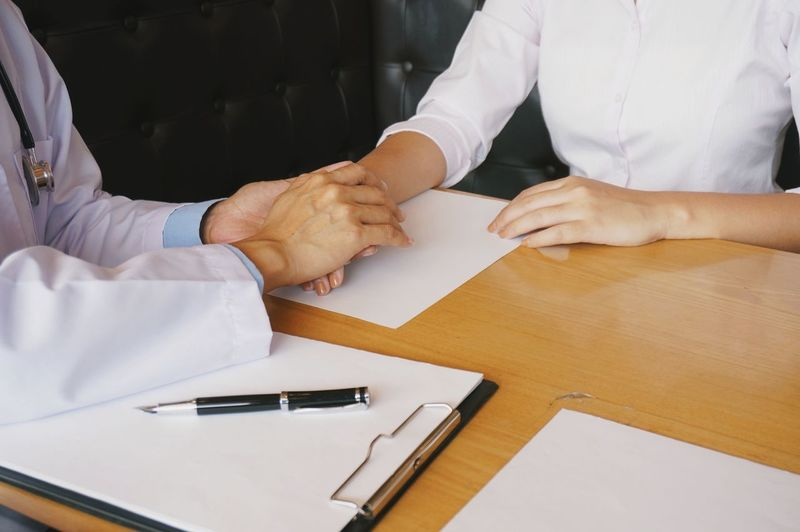 Adult Business Communication Discussion Hand Handshake High Angle View Holding Human Hand Indoors  Meeting Men Midsection Occupation Paper Pen People Real People Table Two People