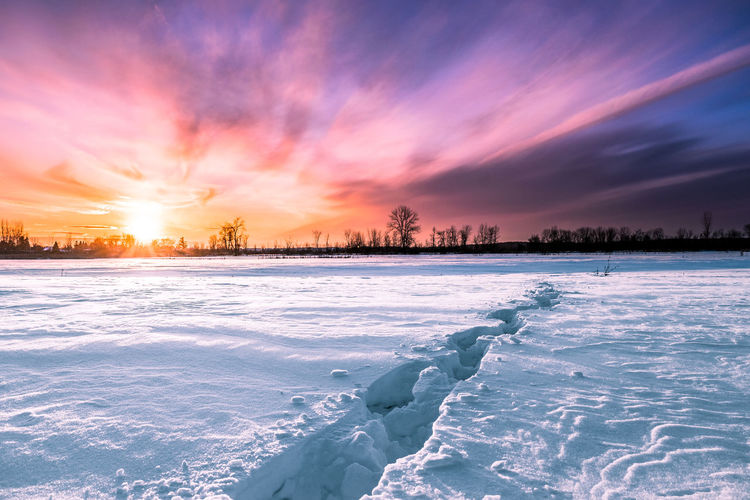 Leading to nowhere🚶 Clouds And Sky Light Field Canada Winter Colorful Colors Sun Bright Colors Track Sunset Cold Temperature Snow Winter Ice Landscape Frozen Pink Color Scenics Cloud - Sky Frost Tree Nature Polar Climate Outdoors Sky Beauty In Nature No People Frozen Water Rural Scene