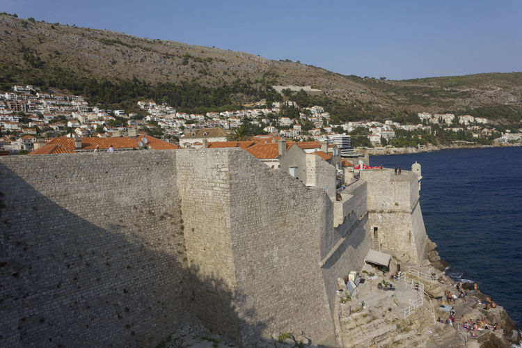 Dubrovnik Dubrovnik, Croatia Croatia Outdoors Cliff Cliffside Walls Fortified Wall Fortified Walls Cityscape Architecture Built Structure Building Exterior Sky Water Building Nature City Sea Clear Sky Day No People Land History Town Wall Residential District The Past Sunlight TOWNSCAPE