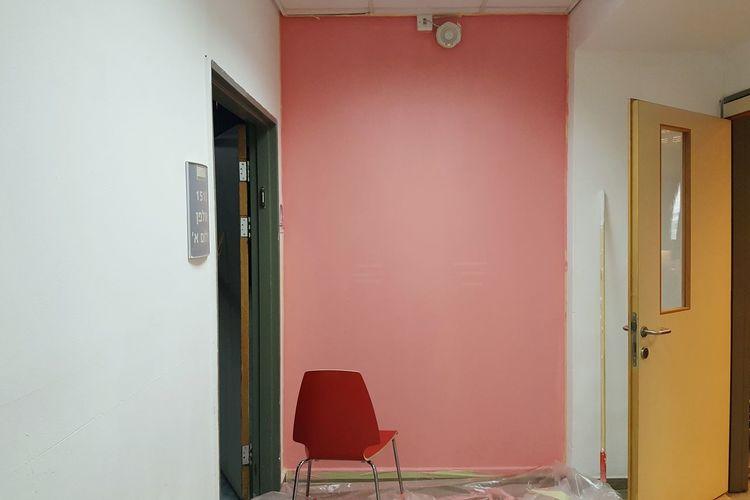 Chair on red door