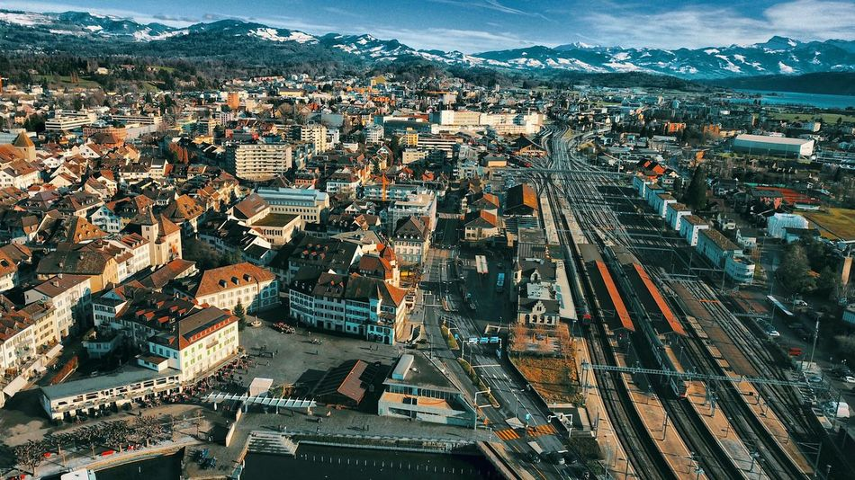 Lovecity  Droneoftheday Dji Mavic Pro Zürich Zürisee Swiss Photos Bahnhof Rapperswil-Jona Rapperswil EyeEm Selects Cityscape City Aerial View High Angle View Architecture Building Exterior Outdoors No People Cloud - Sky Travel Destinations Skyscraper Built Structure Day Urban Skyline Mountain Sky Nature