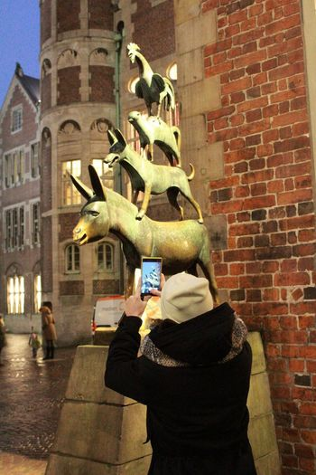 From Amsterdam To Oslo Cycling Around Germany Bremen Bremenmusicians Four Musicians Of Bremen Friend Statue City Women Architecture Building Exterior Built Structure Sculpture HUAWEI Photo Award: After Dark