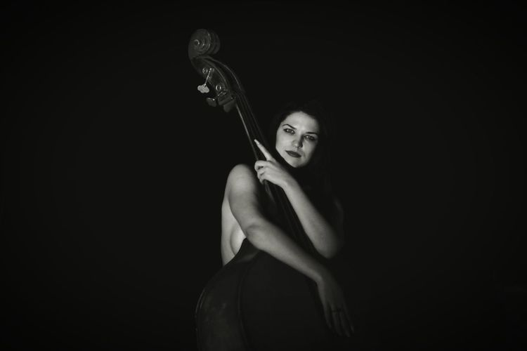 Portrait Of Woman With Double Bass In Darkroom