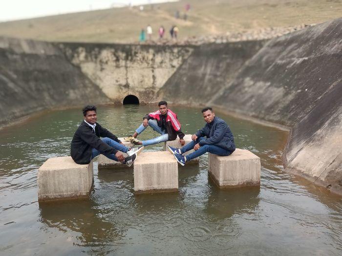 People sitting on floor in water