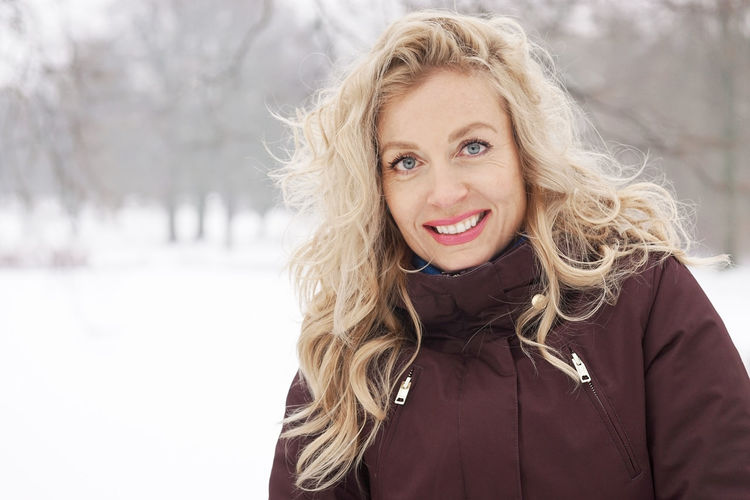 Adult Beautiful People Beautiful Woman Blond Hair Blonde Cheerful Cold Temperature Copy Space Happiness Long Hair Looking At Camera Nature One Person Outdoor Park People Portrait Smiling Snow Snow Covered Toothy Smile Warm Clothing Winter Woman