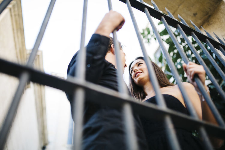 Young couple standing by gate