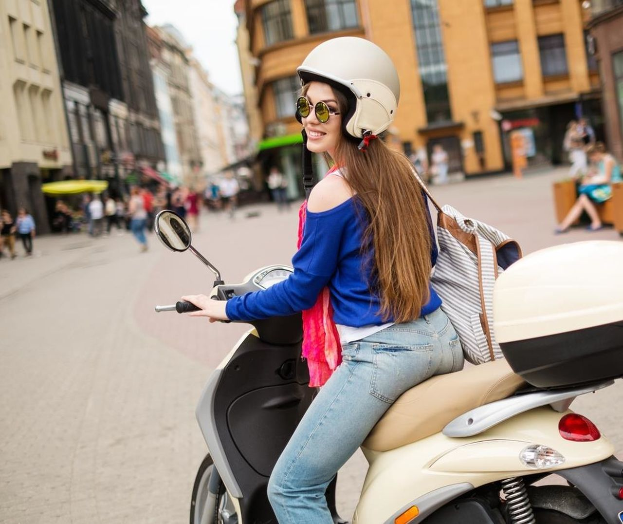 real people, one person, transportation, mode of transport, incidental people, young adult, sunglasses, young women, casual clothing, day, helmet, side view, lifestyles, outdoors, headwear, technology, eyeglasses, smiling, wireless technology, people