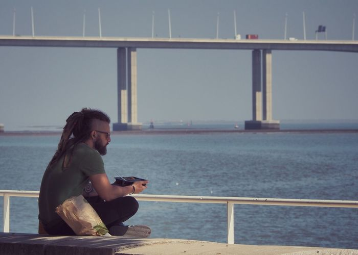 Break Casual Clothing Day Having Lunch Leisure Activity People And Places. Picnic Rastafari Resting Sea Side View Thoughtful Young Adult Meditation Summer Enjoyment City Life Portugal_em_fotos Portugal Is Beautiful Portugal_lovers Lisbon Sunny People Photography Peoplephotography People And Places