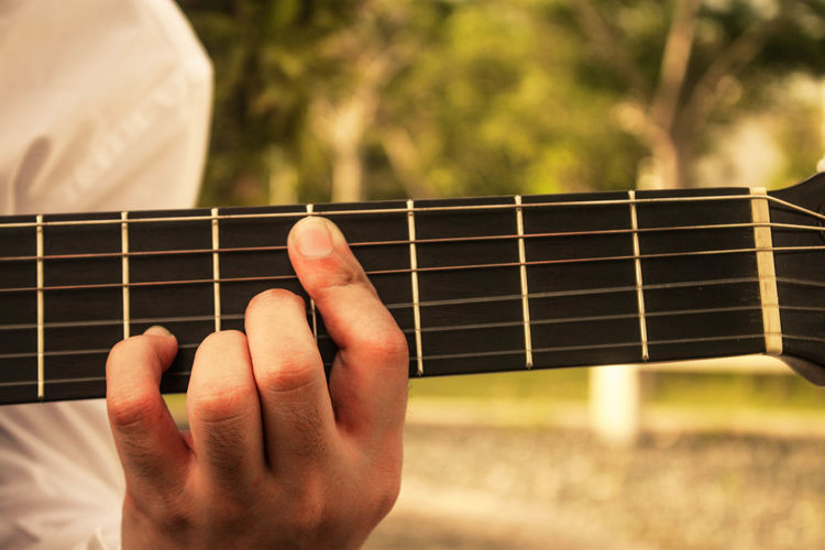 Music to my ears Arts Culture And Entertainment Classical Guitar Close-up Davao City, Philippines Day Guitar Human Hand Lifestyles Music Music To My Ears Musical Instrument Musical Instrument String Musician One Person Outdoors Playing Plucking An Instrument Sunset Boulevard