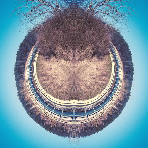 Herr Grinsemann Grin Face HEAD Creative Creativity Portrait Mirrored Symmetry Outdoors Circle Geometric Shape Shape Nature Sky Architecture No People Tree Day Built Structure Digital Composite Plant Blue Fish-eye Lens Water Low Angle View Pattern Blue Background