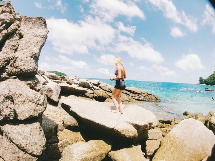 Rock Solid Rock - Object Sky Sea One Person Water Full Length Cloud - Sky Real People Lifestyles Nature Leisure Activity Standing Day Beauty In Nature Beach Women Horizon Over Water Outdoors Looking At View Hairstyle