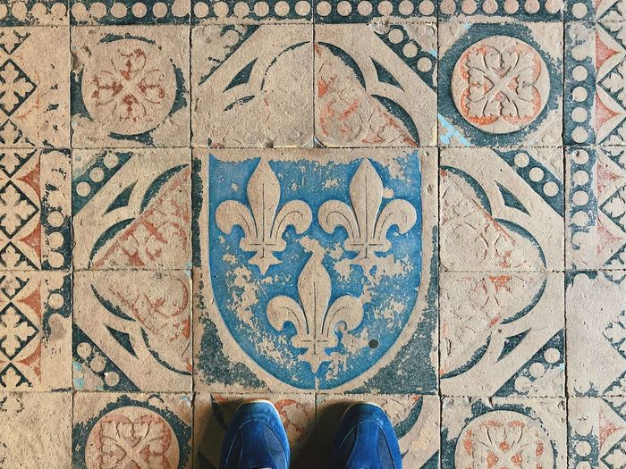 Heraldry... Travel Real People History Pavement Culture Shoes Background Texture Design Stone Tile Symbol Antique Medieval Heraldry Low Section Human Body Part Body Part Human Leg Shoe Personal Perspective Lifestyles Art And Craft Flooring High Angle View Directly Above Creativity Leisure Activity Human Foot Pattern Standing