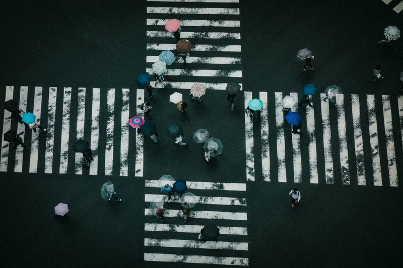 High Angle View City Day Real People Street Road Transportation Group Of People Sunlight Large Group Of People Outdoors Pattern Marking Nature Architecture Road Marking Built Structure Lifestyles Incidental People Walking
