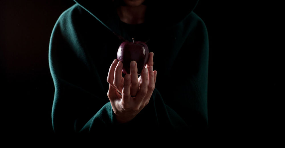 witch Apple Disney Evil Poison Apples Adult Biancaneve Black Background Close-up Human Hand Indoors  One Person People Pois Poisoned Real People Snow White Snowhite Studio Shot Whitesnow Wicked Witch
